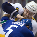 Nashville Predators' Shea Weber (6) and Vancouver Canucks' Luca Sbisa, of Switzerland, fight during the first period of an NHL hockey game in Vancouver, British Columbia, on Sunday, Nov. 2, 2014 The Associated Press