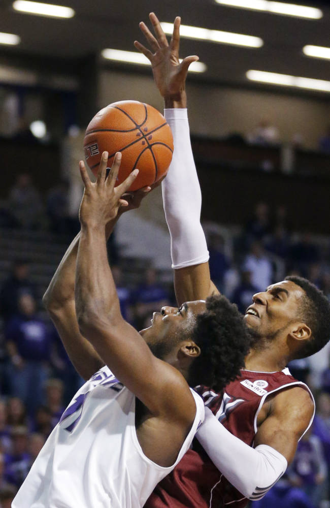 Kansas State forward Nino Williams (11) shoots while covered by Troy forward Westley Hinton, right, during the second half of an NCAA college basketball game at Bramlage Coliseum in Manhattan, Kan., Sunday, Dec. 15, 2013. Kansas State defeated Troy 72-43