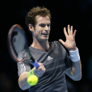 Britain's Andy Murray plays a return to Switzerland's Roger Federer during their singles ATP World Tour tennis finals match at the O2 arena in London, Thursday, Nov. 13, 2014. (AP Photo/Kirsty Wigglesworth)