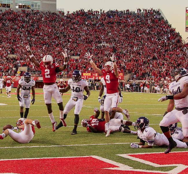 In this image from Nov. 2, 2013, Nebraska players Alonzo Moore (2), Sam Burtch (9) and Quincy Enunwa (18), celebrate a tipped game-winning touchdown pass caught by Nebraska wide receiver Jordan Westerkamp, left, with no time left on the clock, as Northwestern players Ibraheim Campbell (24), Traveon Henry (10), Dwight White (2) and Chi Chi Ariguzo (44)  look on, in an NCAA college football game in Lincoln, Neb., giving Nebraska a 27-24 win. If Nebraska makes it back to the Big Ten championship game, the Cornhuskers might look at Westerkamp's tipped-ball touchdown on the last play against Northwestern as the one that saved their season and maybe even Bo Pelini's job