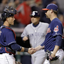 Cleveland Indians catcher Yan Gomes, left, congratulates relief pitcher John Axford after the final out in a 8-6 win over the San Diego Padres in the MLB baseball game Tuesday, April 8, 2014, in Cleveland The Associated Press