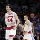 Wisconsin forward Frank Kaminsky, left, and teammate forward Sam Dekker react after beating North Carolina 79-72 in a college basketball regional semifinal in the NCAA Tournament, Thursday, March 26, 2015, in Los Angeles. (AP Photo/Jae C. Hong)