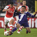 Arsenal's Alexis Sanchez, left, and Anderlecht's Andy Najar, vie for the ball during the Group D Champions League match between Anderlecht and Arsenal at Constant Vanden Stock Stadium in Brussels, Belgium, Wednesday Oct. 22, 2014