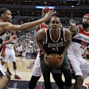 Washington Wizards forwards Otto Porter Jr. (22), Al Harrington and Drew Gooden (90) combine on Milwaukee Bucks center John Henson (31) diuring the first half of an NBA basketball game, Saturday, April 12, 2014, in Washington The Associated Press