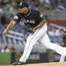 Miami Marlins starter Carlos Zambrano pitches to the San Diego Padres during the third inning of a  baseball game in Miami, Friday, July 27, 2012. (AP Photo/J Pat Carter)