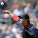 Boston Red Sox Junichi Tazawa pitches in the eighth inning of an exhibition baseball game against the Tampa Bay Rays in Port Charlotte, Fla., Tuesday, March 25, 2014. The Red Sox won 4-2 The Associated Press