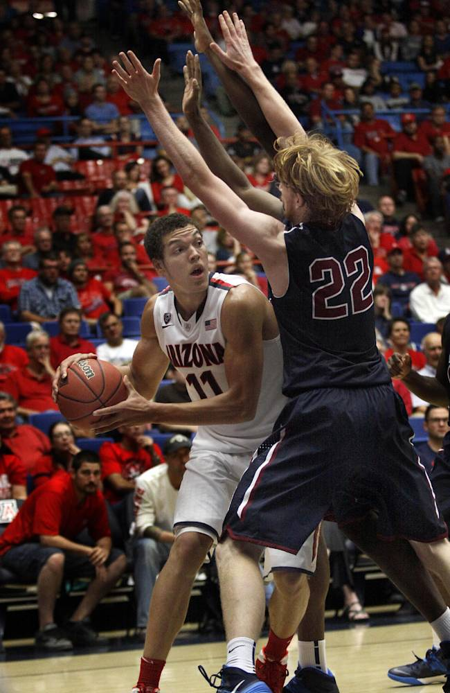 Arizona's Aaron Gordon (11) looks for an opening around Fairleigh Dickinson's Mathias Seilund (22) in the second half of an NCAA college basketball game, Monday, Nov. 18, 2013 in Tucson, Ariz. This is in the first round of the Preseason NIT. Arizona won 100 - 50