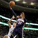 Indiana Pacers point guard C.J. Watson (32) drives to the basket as Boston Celtics center Kris Humphries comes in for the block during the first half of an NBA basketball game on Saturday, March 1, 2014, in Boston The Associated Press