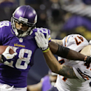 In this Dec. 1, 2013, file photo, Minnesota Vikings running back Adrian Peterson, left, tries to break a tackle from Chicago Bears free safety Chris Conte during the fourth quarter of an NFL football game in Minneapolis. The NFL suspended Adrian Peterson
