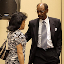 Former Texas Rangers manager Ron Washington escorts his wife Gerry, left, away after Washington made a statement at a news conference, Thursday, Sept. 18, 2014, in Irving, Texas. (AP Photo/Tony Gutierrez)