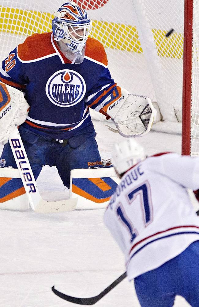 Montreal Canadians' Rene Bourque (17) hits the post as Edmonton Oilers goalie Devan Dubnyk (40) looks for the puck during first-period NHL hockey game action in Edmonton, Alberta, Thursday, Oct. 10, 2013. (AP {Photo/The Canadian Press, Jason Franson)