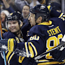 Buffalo Sabres Cody Hodgson, left, celebrates a goal by Chris Stewart against the Ottawa Senators during the first period of an NHL hockey game Monday, Dec. 15, 2014, in Buffalo, N.Y. The goal was not allowed due to a high stick but the Sabres beat Ottaw