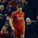 Liverpool's Steven Gerrard rues a missed chance on goal during the English League Cup semi-final first leg soccer match between Liverpool and Chelsea at Anfield Stadium, Liverpool, England, Tuesday Jan. 20, 2015