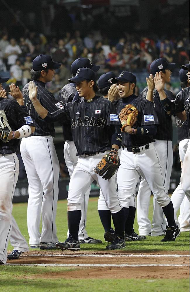 Japan celebrates after beating Taiwan 4-2 during an exhibition game at the Xinzhuang baseball stadium in New Taipei City, Taiwan, Friday, Nov. 8, 2013