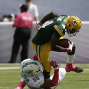 Miami Dolphins defensive end Olivier Vernon (50) tackles Green Bay Packers running back James Starks (44) during the first half of an NFL football game, Sunday, Oct. 12, 2014, in Miami Gardens, Fla The Associated Press
