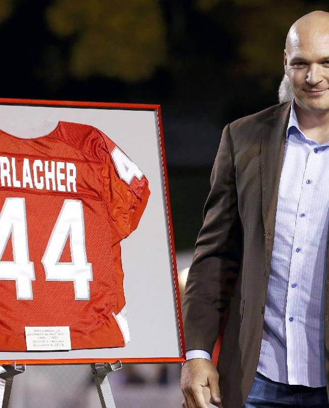 Former New Mexico and Chicago Bears football player Brian Urlacher gives a thumbs up as his jersey number is retired during a halftime ceremony at an NCAA college football game against the Air Force on Friday, Nov. 8, 2013, in Albuquerque, N.M