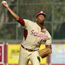 Florida State relief pitcher Jameis Winston (44) warms up in the ninth inning of an NCAA college baseball game against Miami on Sunday, March 2, 2014, in Tallahassee, Fla. Florida State won 13-6. (AP Photo/Phil Sears)