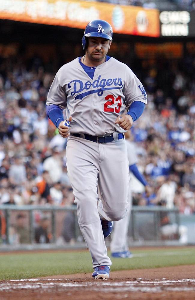 Los Angeles Dodgers' Adrian Gonzalez scores during the fourth inning of a baseball game against the San Francisco Giants, Saturday, July 26, 2014, in San Francisco. (AP Photo/Beck Diefenbach)