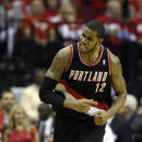 Portland Trail Blazers' LaMarcus Aldridge (12) reacts after making a basket against the Houston Rockets during the third quarter in Game 2 of an opening-round NBA basketball playoff series Wednesday, April 23, 2014, in Houston. Portland won 112-105. (AP Photo/David J. Phillip)