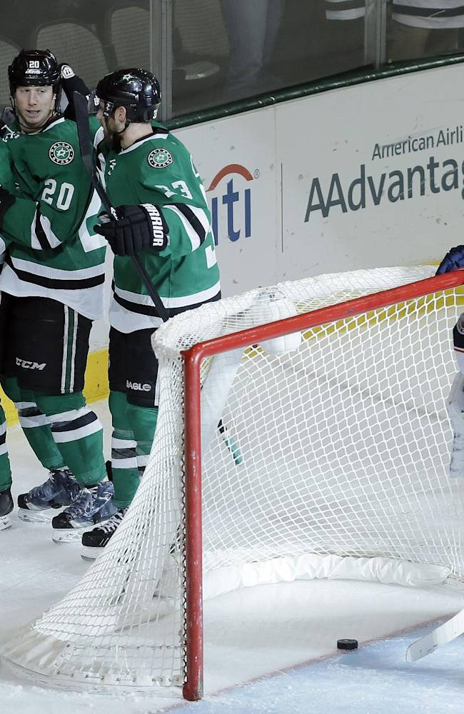 Columbus Blue Jackets goalie Sergei Bobrovsky (72) and forward Mark Letestu (55) look on as Dallas Stars defenseman Trevor Daley (6) is congratulated by teammates after scoring a goal during the third period of an NHL hockey game on Wednesday, April 9, 2014, in Dallas. Columbus won 3-1