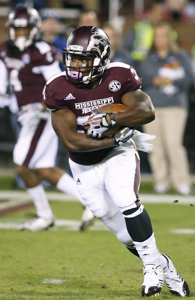 Mississippi State running back Josh Robinson runs upfield against Kentucky in the second half of their NCAA college football game at Davis Wade Stadium in Starkville, Miss., Thursday, Oct. 24, 2013. Mississippi State won 28-22