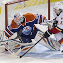 Calgary Flames' Mikael Backlund (11) is stopped by Edmonton Oilers goalie Ilya Bryzgalov (80) during third period NHL hockey action in Edmonton, Alberta, on Saturday March 1, 2014 The Associated Press