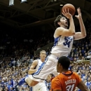 Duke's Ryan Kelly (34) drives to the basket as Clemson's Devin Booker (31) defends during the first half of an NCAA college basketball game in Durham, N.C., Tuesday, Jan. 8, 2013. (AP Photo/Gerry Broome)