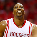 HOUSTON, TX - MAY 25: Dwight Howard #12 of the Houston Rockets wears a ripped jersey in the second quarter against the Golden State Warriors during Game Four of the Western Conference Finals of the 2015 NBA Playoffs at Toyota Center on May 25, 2015 in Houston, Texas. (Photo by Ronald Martinez/Getty Images)