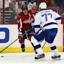 Washington Capitals right wing Alex Ovechkin (8), from Russia, looks to pass past Tampa Bay Lightning defenseman Victor Hedman (77), from Sweden, in the first period of an NHL hockey game on Sunday, April 13, 2014, in Washington The Associated Press