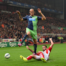 Newcastle United's Gabriel Obertan, in air, battles for the ball with Stoke City's Marc Wilson, during the English Premier League soccer match between Stoke City and Newcastle United, at the Britannia Stadium, in Stoke on Trent, England, Monday Sept. 29,