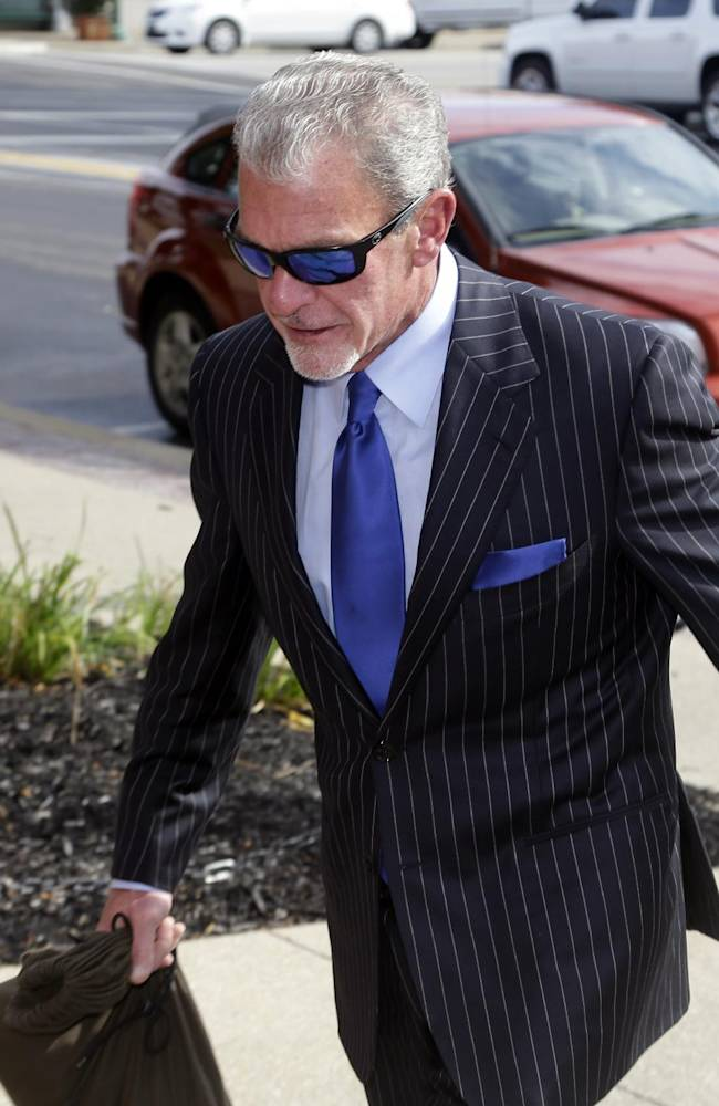 Indianapolis Colts owner Jim Irsay enters Hamilton County court in Noblesville, Ind., Tuesday, Sept. 2, 2014. Irsay is scheduled to appear in court for a change-of-plea hearing on drug-related charges he faces from a traffic stop in March