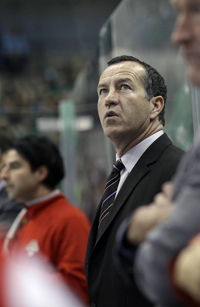 In this Oct. 3, 2013 file photo, Florida Panthers head coach Kevin Dineen watches play from the bench in the first period of an NHL hockey game against the Dallas Stars, in Dallas. Dineen has been fired as coach of the Panthers. The team made the announcement Friday, Nov. 8, 2013, one day after their losing streak reached seven with a 4-1 loss at Boston. Also fired were assistants Gord Murphy and Craig Ramsay. Peter Horachek is the Panthers' interim head coach