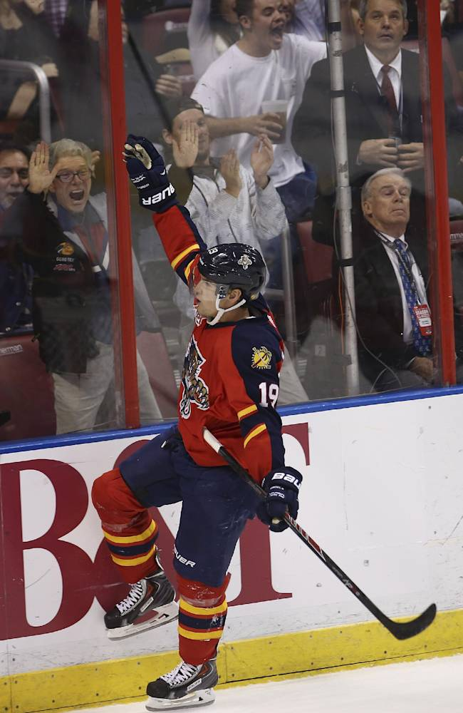 Florida Panthers' Scottie Upshall (19) celebrates after scoring the first of his two goals during the third period of an NHL hockey game against the Edmonton Oilers in Sunrise, Fla., Tuesday, Nov. 5, 2013. The Oilers won 4-3 in overtime. (AP J Pat Carter)
