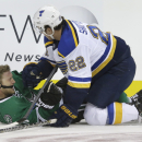 Dallas Stars right wing Ales Hemsky (83) is knocked to the ice by St. Louis Blues defenseman Kevin Shattenkirk (22) during the first period of an NHL pre-season hockey game, Monday, Sept. 22, 2014, in Dallas The Associated Press