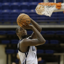 Charlotte Bobcats' Michael Kidd-Gilchrist takes a shot during practice at NBA basketball training camp in Asheville, N.C., Tuesday, Oct. 1, 2013. (AP Photo/Chuck Burton)