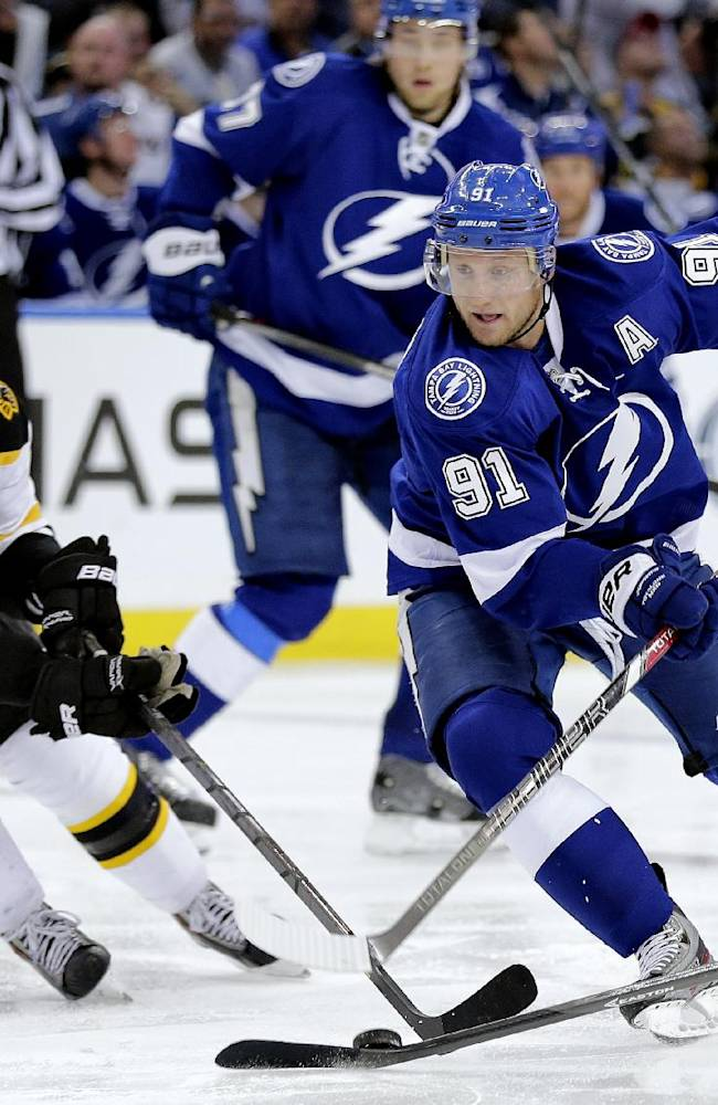 Tampa Bay Lightning center Steven Stamkos (91) cuts in front of Boston Bruins center David Krejci (46), of the Czech Republic, during the second period of an NHL hockey game Saturday, Oct. 19, 2013, inTampa, Fla