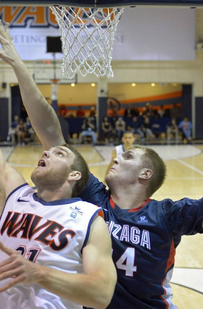 Pepperdine forward Brendan Lane, left, puts up a shot as Gonzaga center Przemek Karnowski defends during the second half of an NCAA college basketball game, Thursday, Jan. 16, 2014, in Malibu, Calif