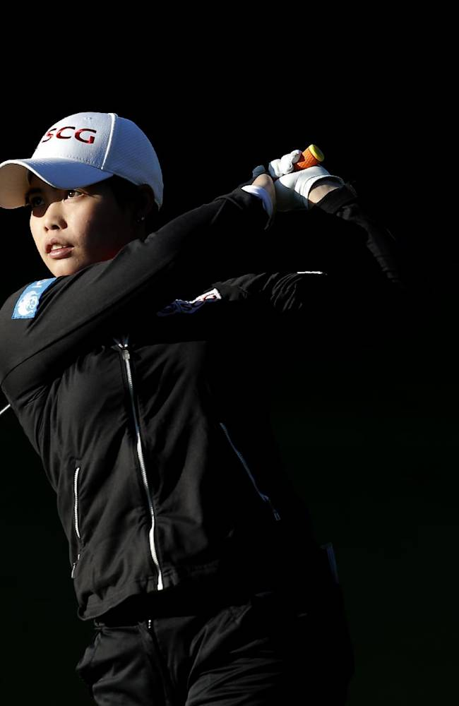 Moriya Jutanugarn of Thailand plays on the 13th hole during the first round of the Evian Championship women's golf tournament in Evian, eastern France, Friday, Sept. 13, 2013