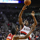 Houston Rockets's James Harden (13) defends a shot by Portland Trail Blazers' Wesley Matthews (2) during the second half of an NBA basketball game in Portland, Ore.,Thursday Dec. 12, 2013. Portland beat the Rockets 111-104 The Associated Press
