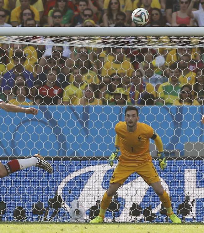 Germany's Mats Hummels, second left, scores the opening goal during the World Cup quarterfinal soccer match between Germany and France at the Maracana Stadium in Rio de Janeiro, Brazil, Friday, July 4, 2014