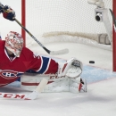 New York Rangers' Carl Hagelin scores on Montreal Canadiens goaltender Carey Price during the first period of an NHL hockey game Saturday, Oct. 25, 2014, in Montreal The Associated Press