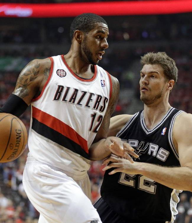 San Antonio Spurs' Tiago Splitter, right, guards Portland Trail Blazers' LaMarcus Aldridge (12) in the first quarter during Game 3 of a Western Conference semifinal NBA basketball playoff series Saturday, May 10, 2014, in Portland, Ore