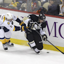 Pittsburgh Penguins' Sidney Crosby (87) tries to control the puck in front of Nashville Predators' Shea Weber in the first period of an NHL hockey game, Sunday, Feb. 1, 2015 in Pittsburgh The Associated Press