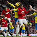 Manchester United's Robin van Persie, centre right, jumps for the ball against Newcastle's Fabrizio Coloccini, centre, during their English Premier League soccer match at Old Trafford Stadium, Manchester, England, Saturday Dec. 7, 2013