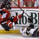 Ottawa Senators' Zack Smith, left, trips over Pittsburgh Penguins' Matt Niskanen during the first period of Game 4 of their NHL Stanley Cup Eastern Conference semifinal NHL hockey series in Ottawa on Sunday, May 19, 2013. (AP Photo/The Canadian Press, Patrick Doyle)