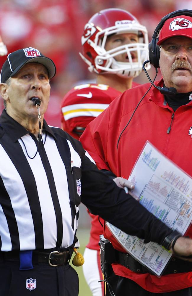 Kansas City Chiefs head coach Andy Reid, right, watches the clock with head linesman Tony Veteri, left, during the second half of an NFL football game against the Cleveland Browns in Kansas City, Mo., Sunday, Oct. 27, 2013. The Chiefs defeated the Browns 23-17