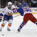 New York Rangers defenseman Ryan McDonagh (27) defends New York Islanders center Frans Nielsen (51) of Denmark during the first period of an NHL hockey game at Madison Square Garden in New York, Tuesday, Jan. 13, 2015 The Associated Press