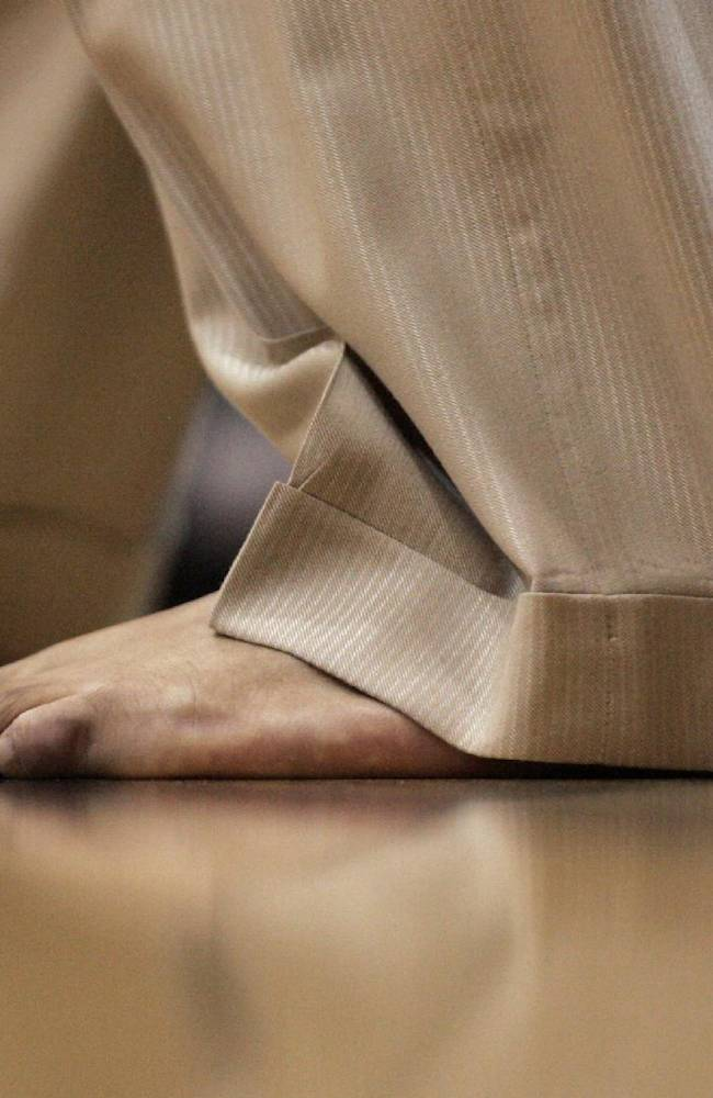 In this Jan. 24, 2008, file photo, then-IUPUI coach Ron Hunter coaches barefoot as his team played Oakland University in an NCAA college basketball game in Indianapolis. Now at Georgia State, Hunter will coach Saturday in his bare feet once again, drawing attention to his real passion, providing shoes to millions of poor children around the world