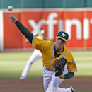 Oakland Athletics pitcher Sonny Gray throws to the Kansas City Royals during the first inning of a baseball game, Friday, Aug. 1, 2014, in Oakland, Calif. (AP Photo/George Nikitin)