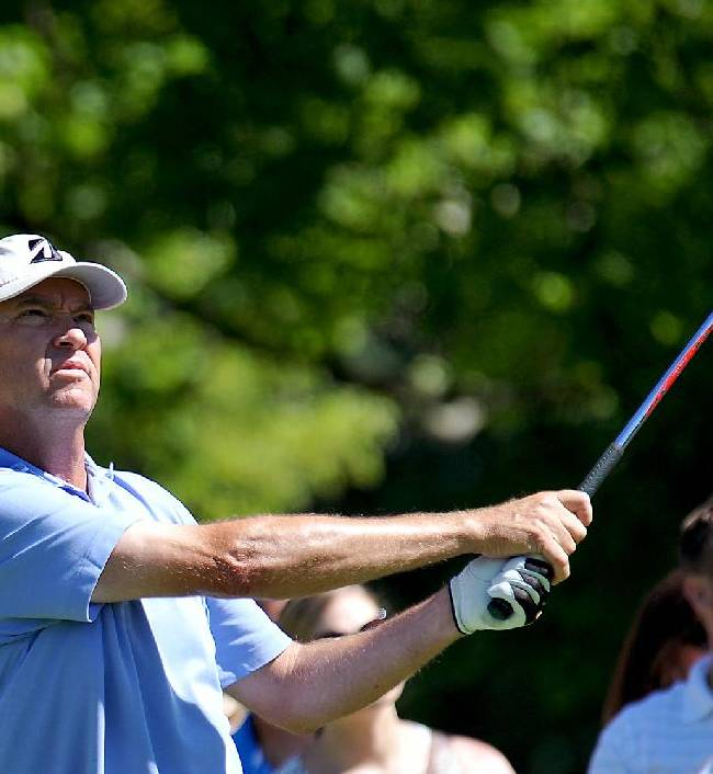 Davis Love III tees of on the 18th hole during the third round of the Greenbrier Classic golf tournament at Greenbrier Resort in White Sulphur Springs, W.Va., Saturday, July 5, 2014